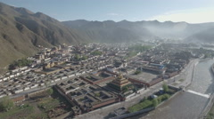 Beautiful aerial view of massive Tibetan Labrang monastery complex in China Stock Footage