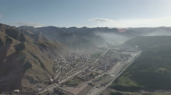 High angle aerial view Tibetan monastery and high altitude mountains China Stock Footage