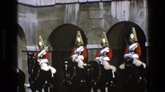 1969: people in uniforms on horses sit while horses buck their heads ENGLAND Stock Footage