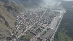 Aerial view of Tibetan Labrang monastery in mountainous region China Stock Footage