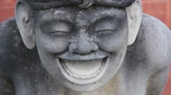 Statue of a Smiling Man Stock Footage