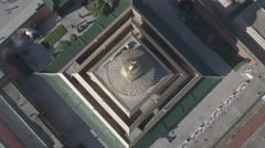 Static aerial shot of a golden stupa pagoda in Tibetan monastery Stock Footage