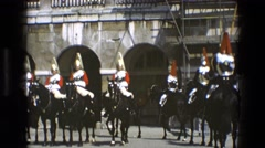 1969: men in period military uniforms lining up in formation while riding horses Stock Footage