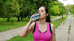 Running and Drinking Water During Training Stock Footage