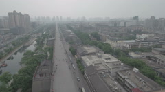 Reverse aerial footage of the city walls of Xi'an in China Stock Footage
