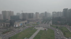 Aerial view of a shopping mall and commercial business district in Xi'an China Stock Footage