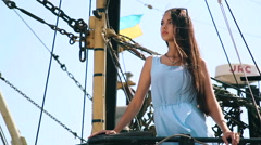 Girl on the ship on the background National colours of Ukraine. Brunette Girl on Stock Footage