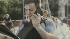 Double exposure, man speaking by phone in city Stock Footage