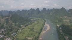Aerial panorama of beautiful Li River meandering through karst scenery Stock Footage