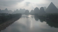 Drone flight over mysterious landscape, misty morning in Yangshuo China Stock Footage