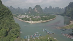 Aerial establishing shot of a heart shaped island along the Li river in China Stock Footage