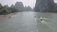 Flying over motorized rafts on the Li River, tourism in China Stock Footage