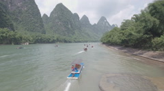 Aerial view of Chinese tourists sailing across the Li river on rafts Stock Footage