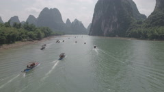 China tourism, drone shot of people sailing over Li river on rafts Stock Footage