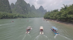 China tourism, flying over motorized rafts on Li river, mountain scenery Stock Footage