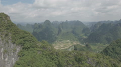 Flying over green mountains revealing spectacular iconic Chinese karst landscape Stock Footage