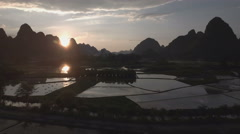 Tranquil rural aerial scene at sunset in China Stock Footage