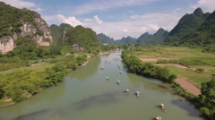 China travel, drone shot of tourists sailing through beautiful mountain scenery Stock Footage