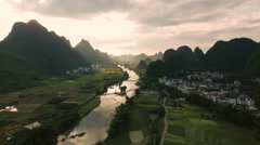 Peaceful idyllic aerial scene of a beautiful rural region in China at sunset Stock Footage