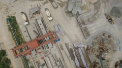 Overhead aerial drone view of a cement (concrete) factory in China Stock Footage