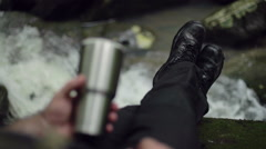 Male Hiker's Boots as He Rests Near Creek Stock Footage