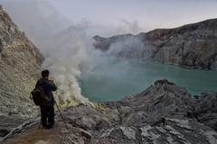 JAVA, INDONESIA - AUGUST, 9, 2016 - Miners are carrying sulfur from Ijen Volc Stock Photos