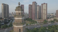 Drone shot of traditional pagoda building, contrast modern towers in China Stock Footage