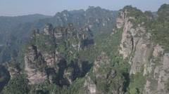 Flying towards beautiful mountain landscape of Zhangjiajie national park China Stock Footage