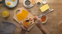 Male hands preparing breakfast toast with jam, top view Stock Footage