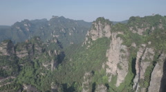 Flying backwards out of a wonderful mountain panorama in China Stock Footage