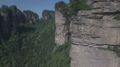 Flying closely past a natural wall in the Zhangjiajie national park in China Stock Footage