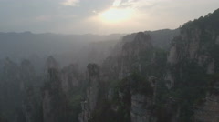 Drone shot of stunning rock formations and stone pillars at sunset in China Stock Footage