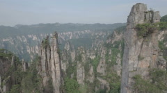 Drone shot through spectacular pillars, mountain scenery Zhangjiajie China Stock Footage