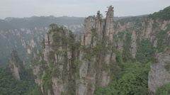 Slow aerial drone flight to pillars Zhangjiajie mountain landscape in China Stock Footage