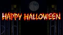 Fire inscription Happy Halloween in moonlit night Stock Footage