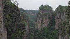 Flying through 'vertical mountains' in the Zhangjiajie national park in China Stock Footage