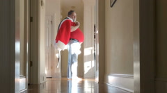 Man with Santa suit at the end of a long night Stock Footage