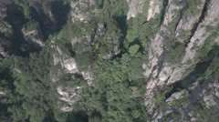 Overhead drone shot flying over stone forest peaks in Chinese national park Stock Footage