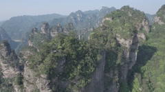 Flying over panoramic mountain landscape in Zhangjiajie national park China Stock Footage