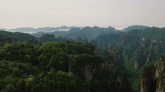 Beautiful panoramic aerial shot over Zhangjiajie mountain landscape Stock Footage