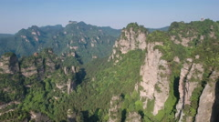 Reverse aerial shot of stunning mountain panorama in China Asia Stock Footage