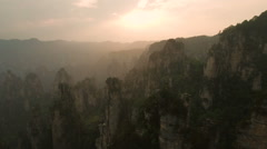 Aerial sunset view of stunning mountain panorama in national park China Asia Stock Footage