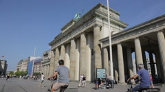 Tourist walking past the Brandenburg Gate, Berlin Germany Stock Footage