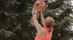 Arm Workout With Baby Stock Footage