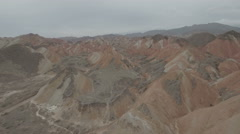 Low drone aerial of surreal remote landscape of Danxia national park in China Stock Footage