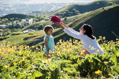 Mother putting hat on toddler, hiking the Bonneville Shoreline Trail in the Stock Photos