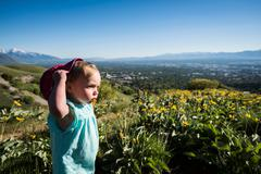 Young girl in field, Bonneville Shoreline Trail in the Wasatch Foothills above Stock Photos