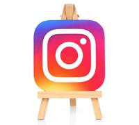 Instagram icon printed on paper and placed on wooden easel Stock Illustration