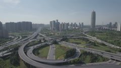 Aerial drone shot of massive intersection and modern skyline Zhengzhou China Stock Footage