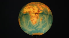 Planet earth globe spinning and stopping on Africa Stock Footage